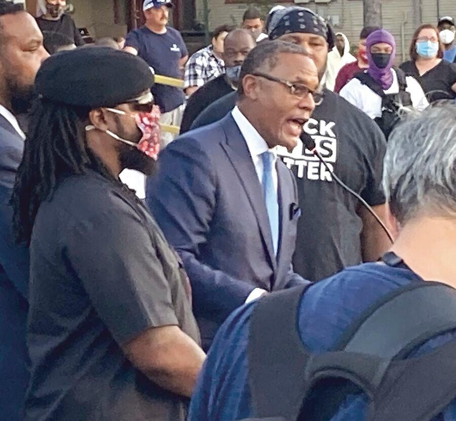 Speaking at vigil