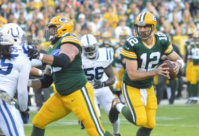 Aaron Rodgers looks to pass