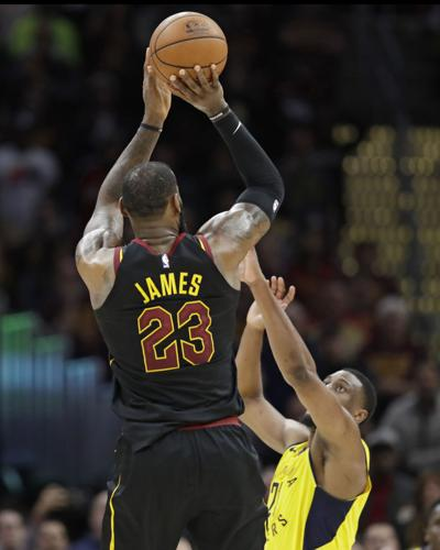8bccb313f8c3 Cleveland Cavaliers  LeBron James (23) shoots a game-winning 3-point shot over  Indiana Pacers  Thaddeus Young (21) in the second half of Game 5 of their  ...