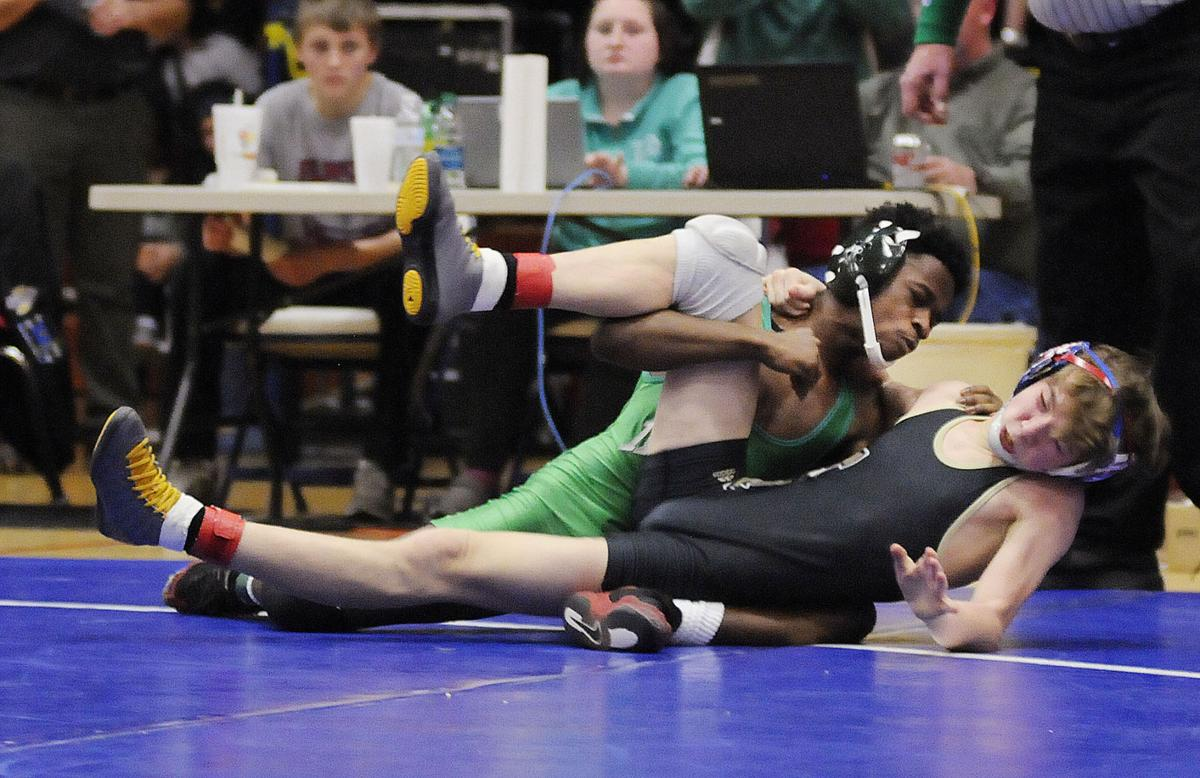 Anderson's Willie Dennison wrestles Noblesville's Joey Kitko in the  113-pound championship during the wrestling sectional at Elwood on Saturday.