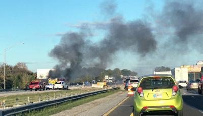 Michigan man, son survive fiery crash on Interstate 69