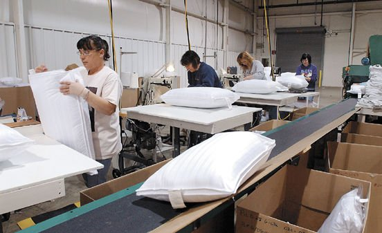 8 59 p m reopened pillow factory comforts local workers life times. Black Bedroom Furniture Sets. Home Design Ideas