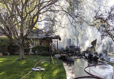 Garage fire spreads to house