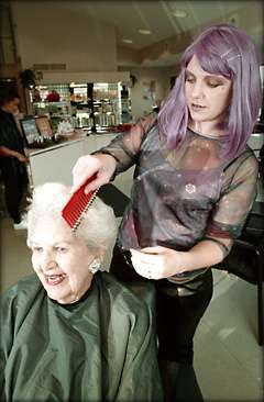 Costumed Coiffure Sporting A Purple Wig As Part Of A Hallowen