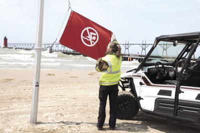 SHAES red beach flag photo