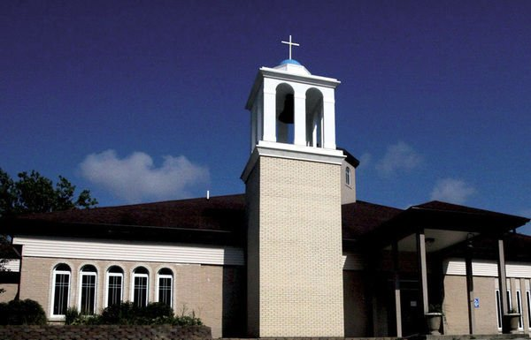 Couple honored for adding bell tower to Greek Orthodox Church