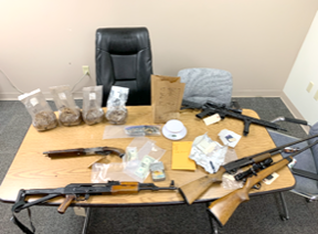 suspect's drugs and guns