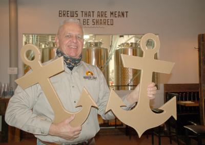 Tom Feeney holding anchors