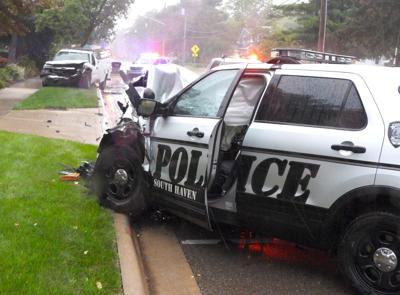SHAES wrecked police car