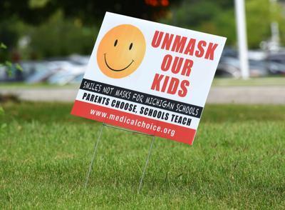 unmask kids sign.jpg