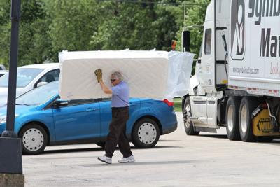 Bill Leiser Carrying A Mattress Across Main Street Is Still Common Scene In Downtown Herscher Who Grew Up The Family Business Turns 80 Next
