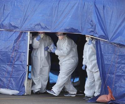 Hospital sets up tents for virus testing