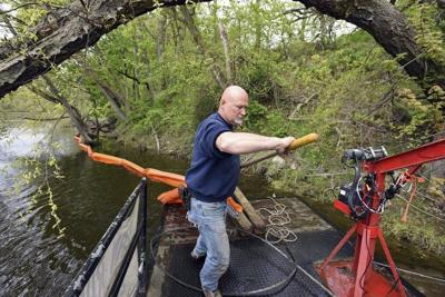 Devices collect debris from river
