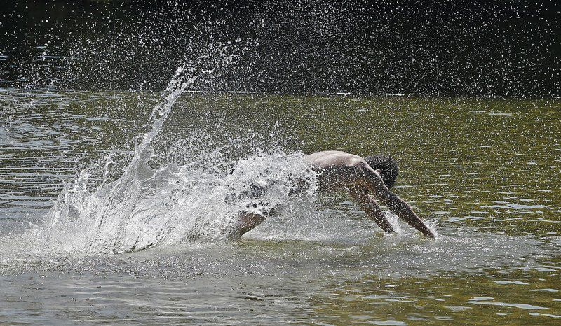 Plug Pond reopens to thrilled swimmers