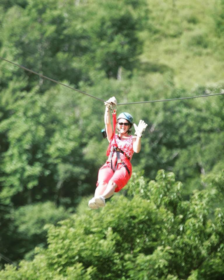 Join the birds in the trees by ziplining through the mountains