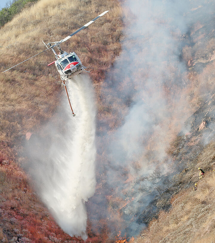 Cal Fire 301 douses flames during Easton Fire