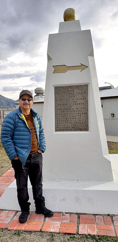 Author Mark Landis stands by the Santa Fe and Salt Lake Monument
