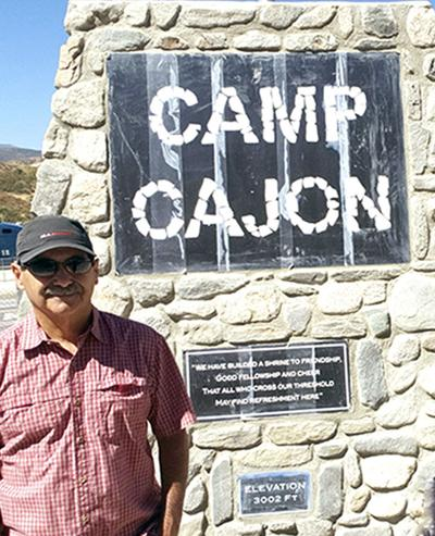 Mark Landis stands beside the newly constructed Camp Cajon Monument
