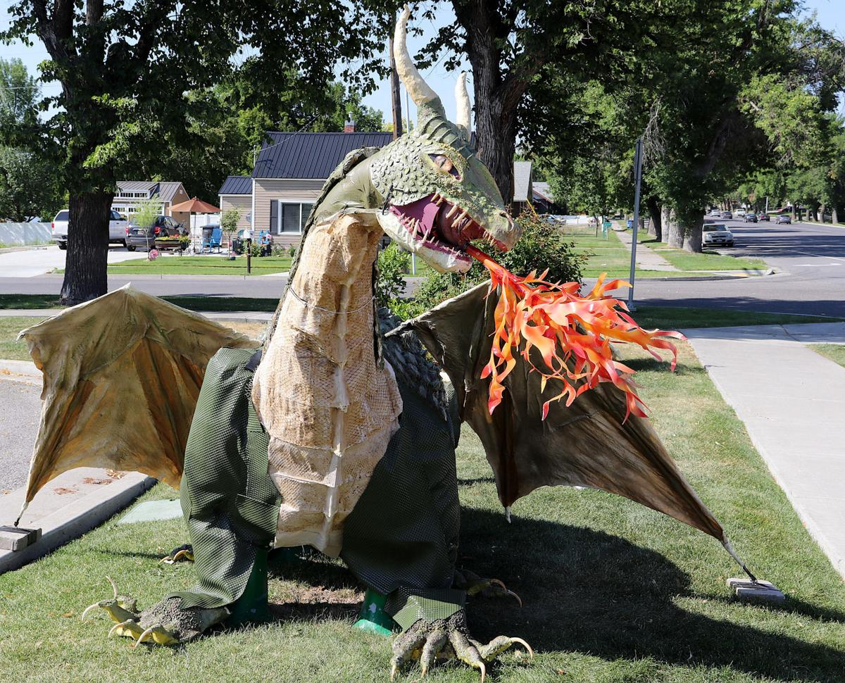 Summer scorcher: Smithfield dino sculpture sprouts wings, spouts fire thanks to Benson couple