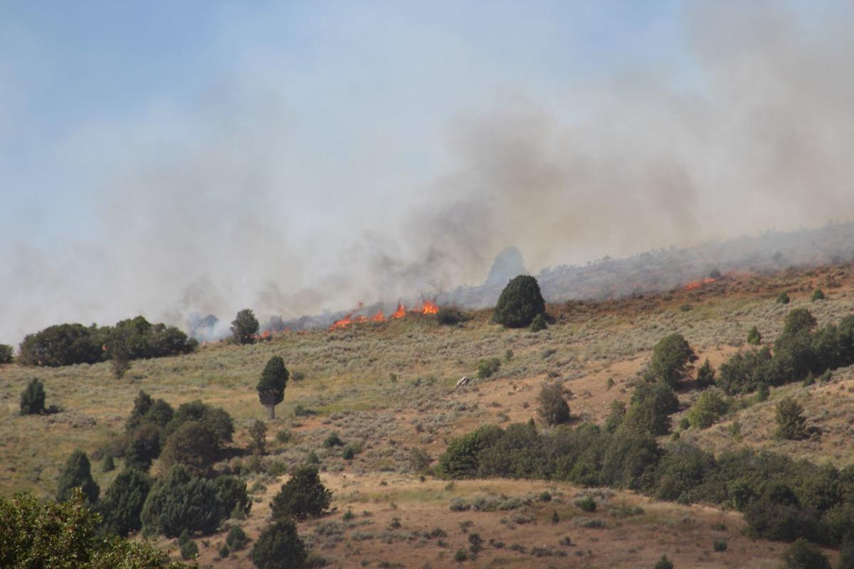 Fire burns across mountaintop in Treasureton