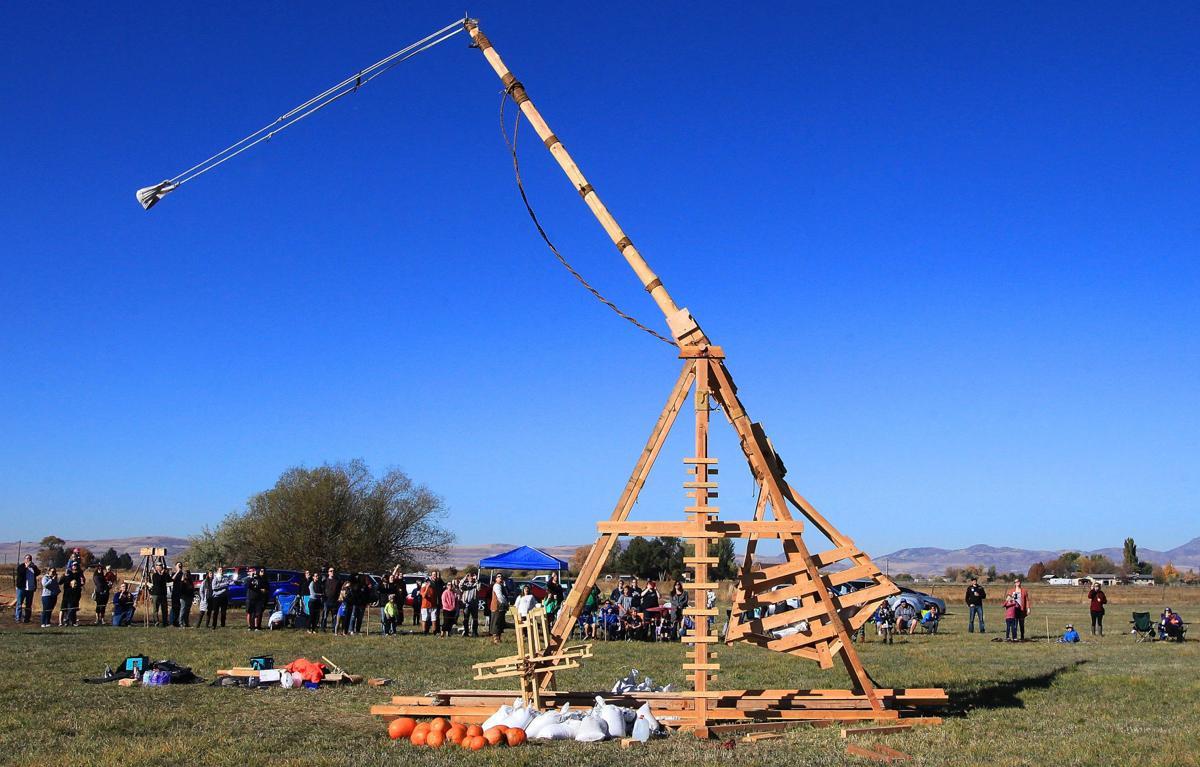 Experimental history: USU student demonstrates trebuchet built with medieval methods