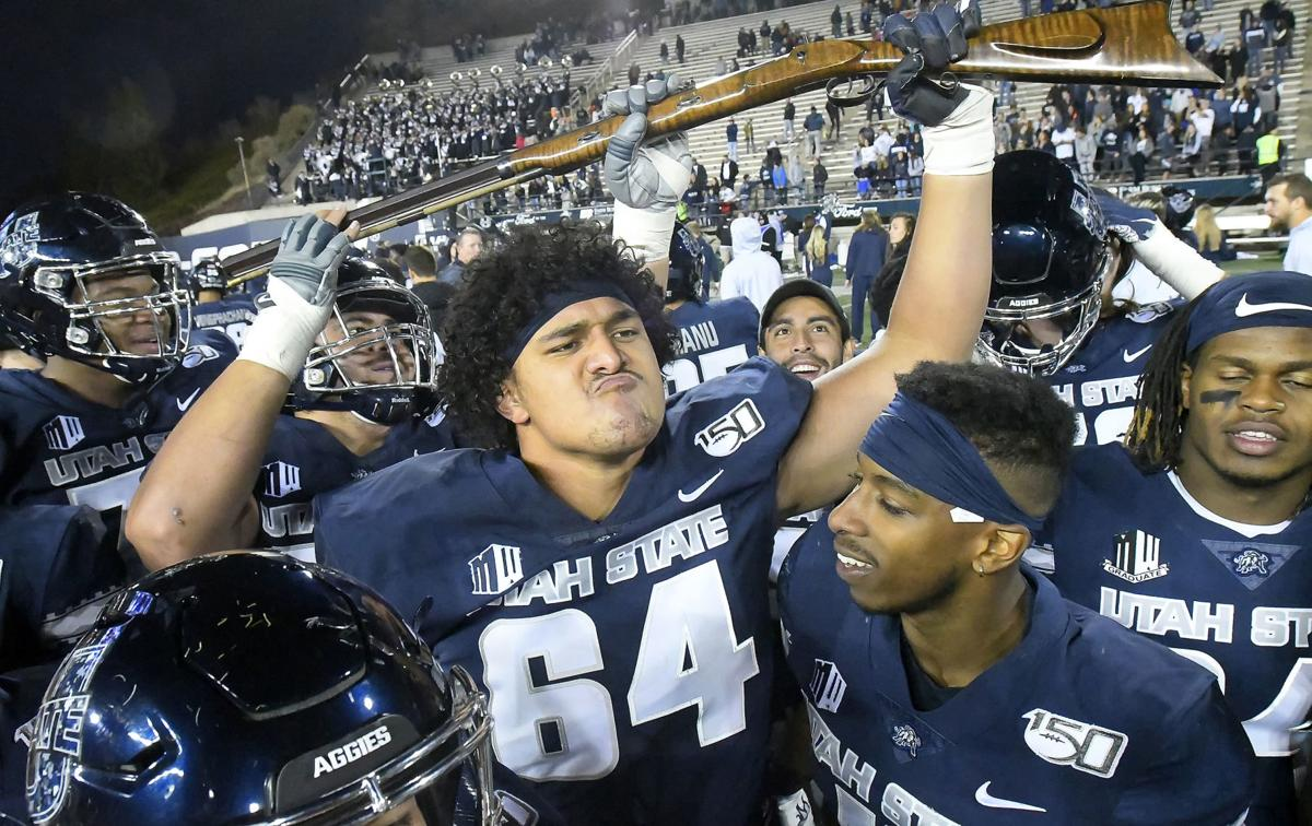 Aggies hold off Cowboys, become bowl eligible