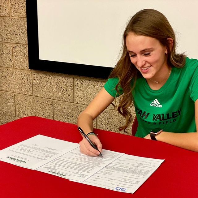 White signs with UVU