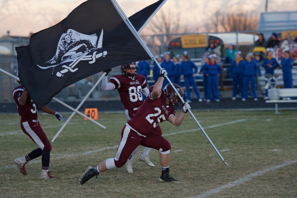 Jaxon Moser planting the Pirate flag to open the match.jpeg