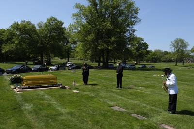 Virus Outbreak Lonely Funerals Photo Gallery