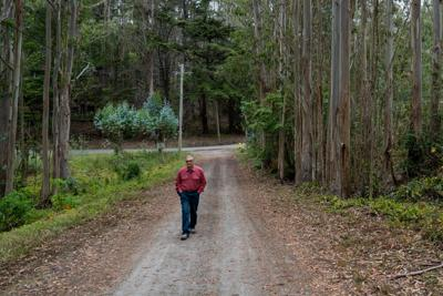 Larry De Young near his property