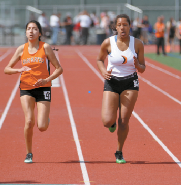 Siobhan Calhoun has enough at the end to hold off San Mateo's Natalia Diaz  Amabilis to take third in the 400-meter dash. Mark Foyer / Review