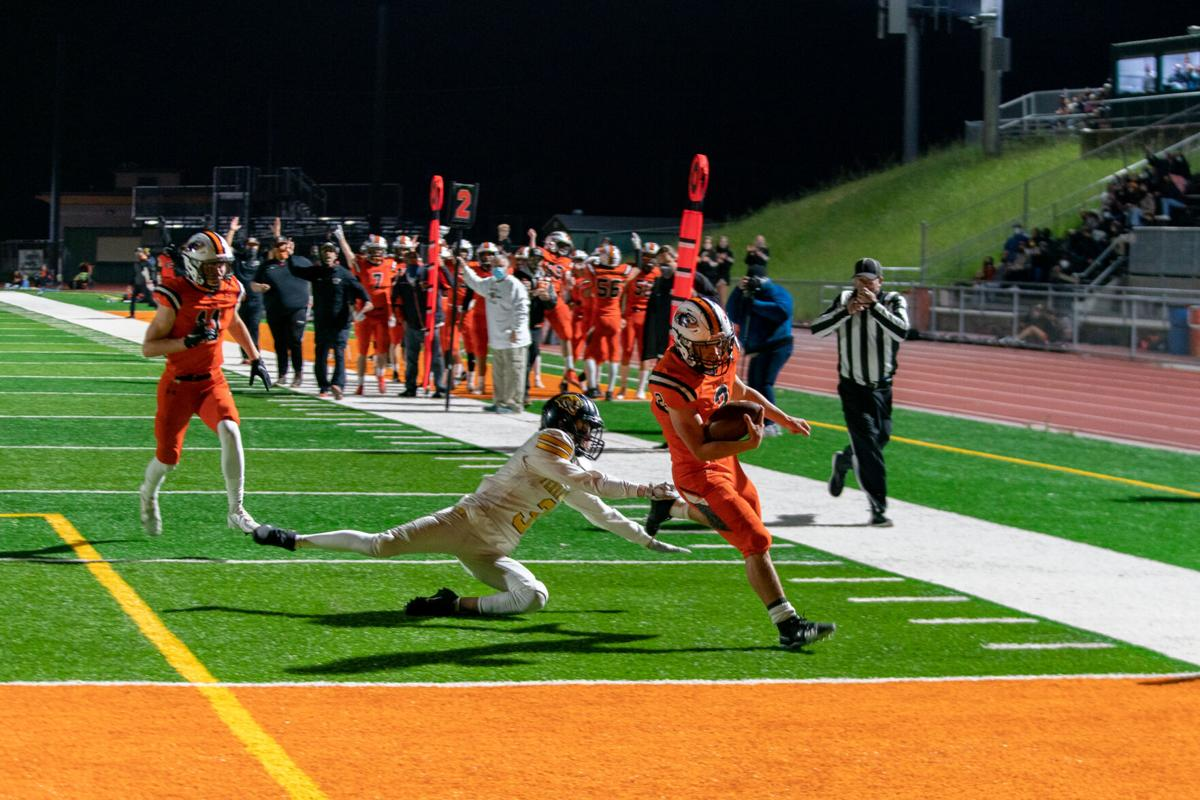 Connor Quosig sprints into the endzone