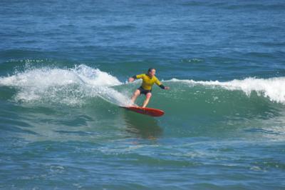 Greg Gubser rides a wave during Kahuna Kupuna
