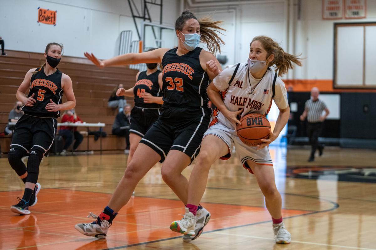 Alli Dioli drives the ball toward the basket