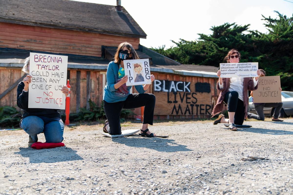 South Coast BLM kneel during Protest
