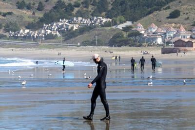 Surfer on Linda Mar Beach