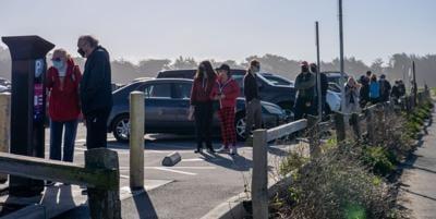 Long lines at Poplar Beach Parking Lot