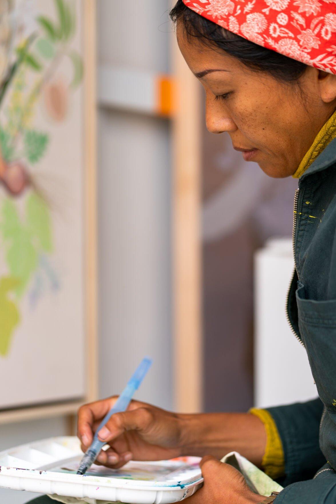 Jane Kim painting in studio