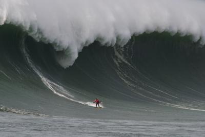 Peter Mel surfs large wave at Mavericks