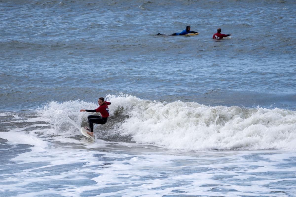 Surfer cuts a wave