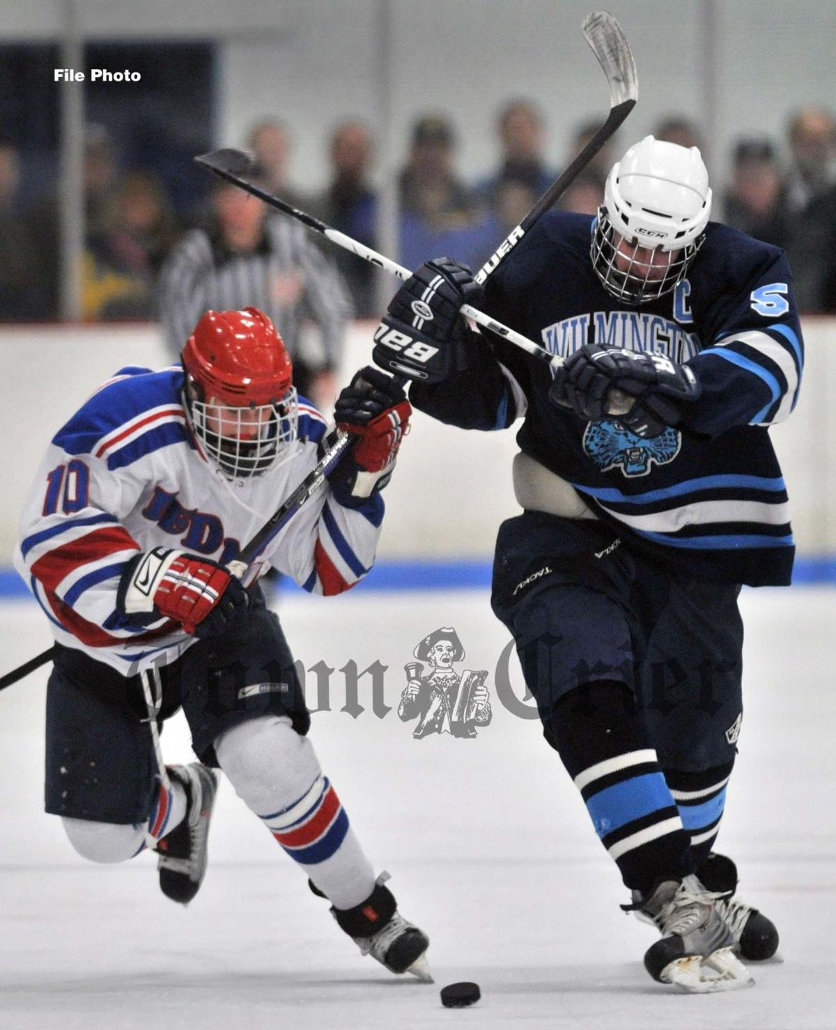 Danny Cushing, right, of the Town Crier's WHS Boys Hockey All-Decade team
