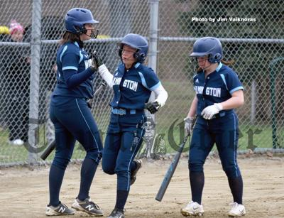 Sisters Kacie and Kayla Bourrell are greeted by teammate Isabella Kieran