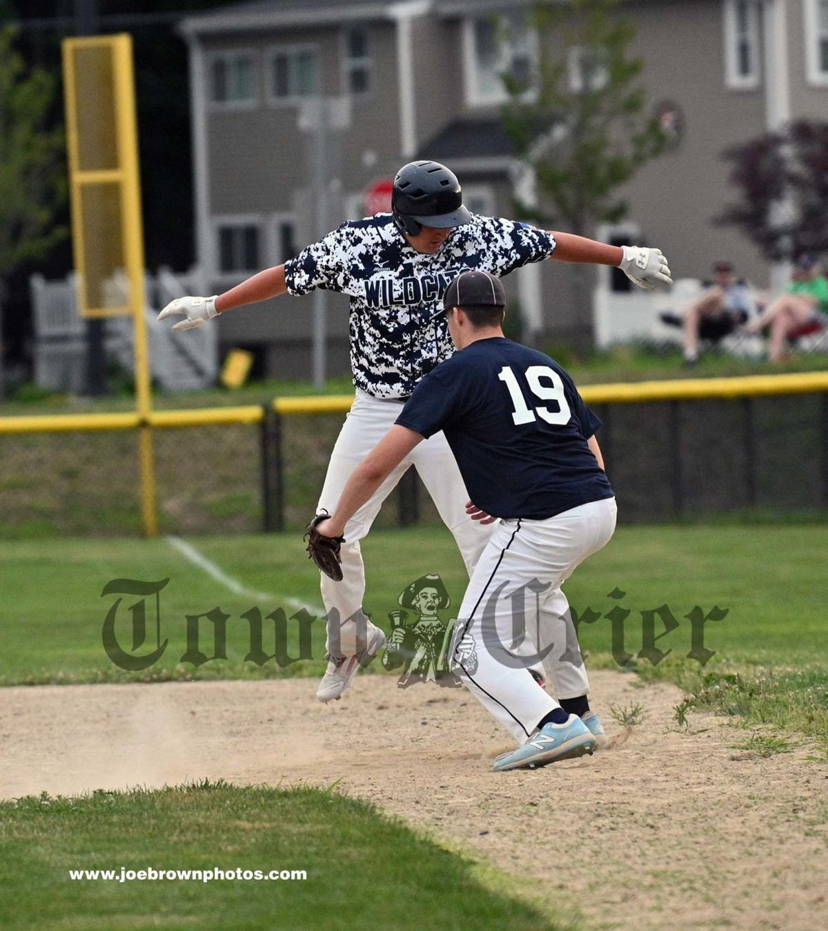 Wilmington Northeast player Vinnie Scalfani gets back to first base