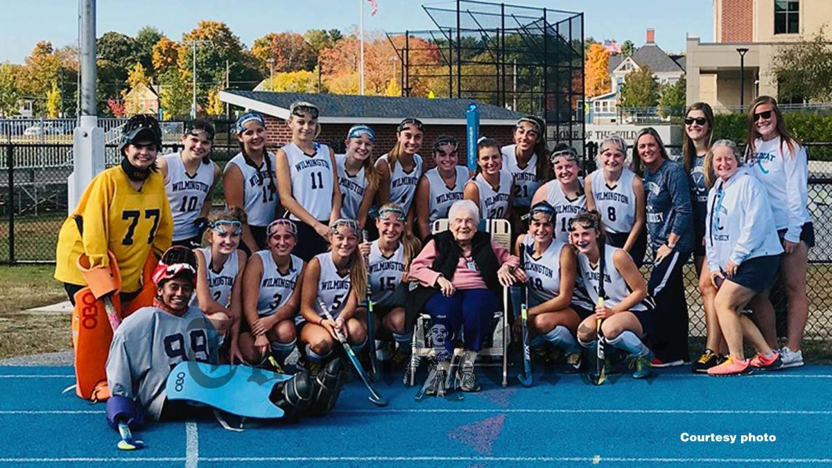 97-year-old Emily Dukas watches WHS Field Hockey team