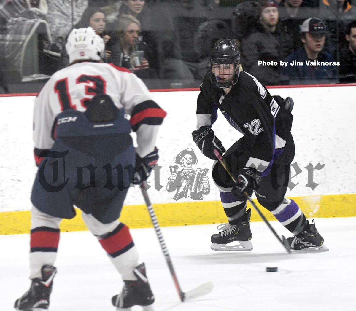 Shawsheen Tech's Brady McFadden tries to make a move on a Lynn defenseman