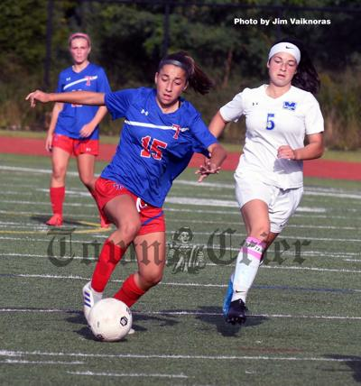 Tewksbury's Daniela Almeida carries the ball towards the goal