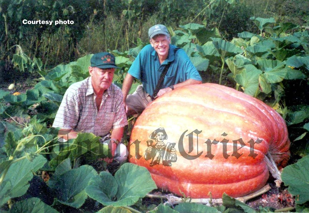 Hugh Wiberg, front, and one of his famous Jack-o-Lantern Pumpkins