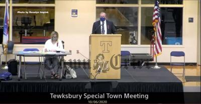 Todd Johnson presides over special Town Meeting