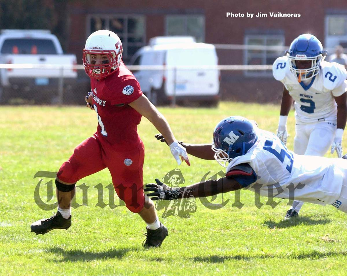 Tewksbury High running back Kyle Darrigo carries the ball