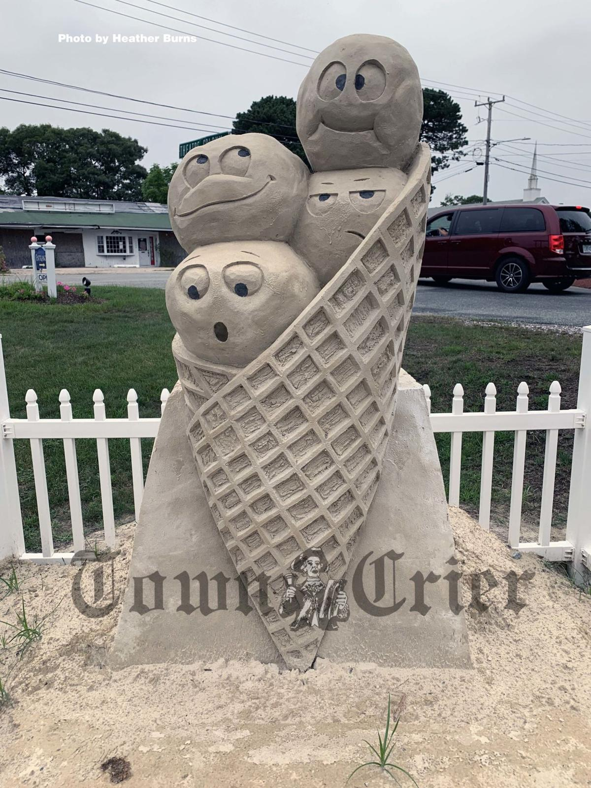 Sand sculpture of a whimsical ice cream cone